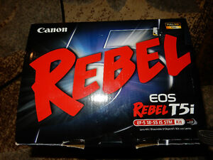 Canon Rebel EOS T5i with 18-55 lens kit near new open box.