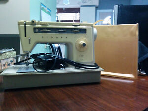 Two Singer Sewing Machines Older