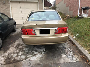 Reduced! ONLY 1300! GOLD KIA MAGENTIS