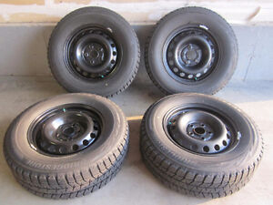 4 Winter tires: 235/65R16 Bridgestone Blizzak WS 80 103T Kitchener / Waterloo Kitchener Area image 1