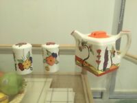 Art Deco teapot and salt n pepper style Clarice cliff