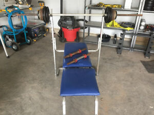 75lbs of rusty weights and older weight bench
