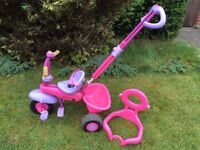 Smart trike in pink with parent handle bike