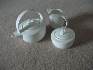 teapot with creamer and sugar
