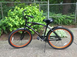 Black and orange cruiser bike