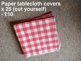 Red gingham paper tablecloth covers