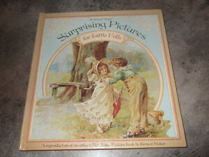 Surprising Pictures A revolving book  by Ernest Nister MINT