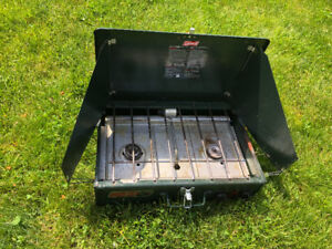 Coleman camping stove complete with pots, plates and cups