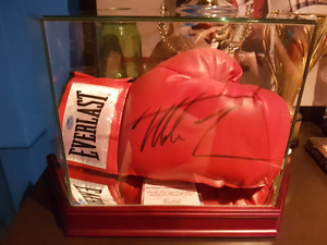 Mike tyson signed glove in glass case