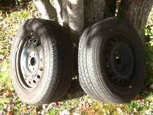 Two 215 60 16 all season tires on 5X114.3 steel rims (215/60R16)
