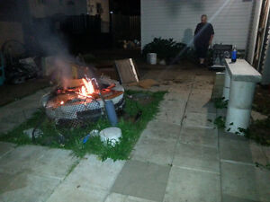 Concrete fire pit and stone surrounding