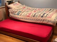 Solid pine single bed with pull out single bed underneath. 2 mattresses included