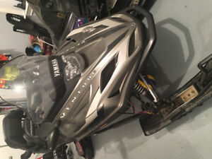 2003 Yamaha venture. Needs new track and suspension parts.