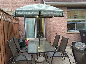 PAtio set with umbrella and four chairs for $175