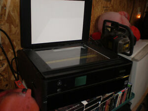epson printer - photo copier, also prints dvds...