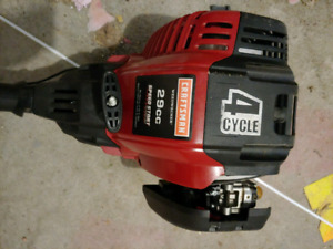 Craftsman 4 cycle 29 cc Weed Wacker with edger.