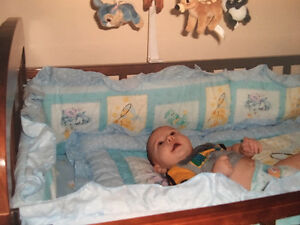 Crib with mattress and care bear comforter set