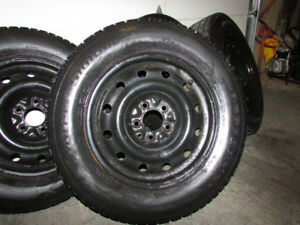 WINTER TIRES ON RIMS 215-65-16 BF GOODRICH WINTER SLALOMS