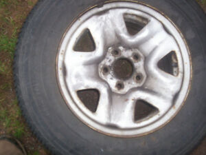 Two Toyota Tacoma 5 bolt wheels with P215/70R15 tires