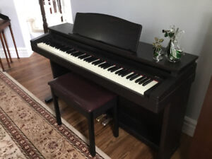 Roland HP 230 digital piano with 52 fully weighted keyboard
