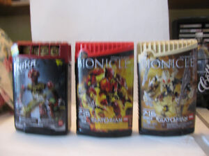 Five Bionicle Lego Figures in Sealed Canisterss