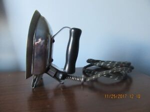 Antique travel iron