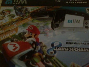 Wii u console with controller sensor and 3 games