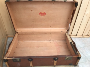 Price reduced:  2 Antique 1940's canvas, wood and metal trunks
