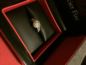 18K White Gold Glacier Fire engagement ring & wedding band.