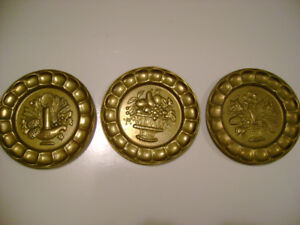 Set of 3 vintage brass decorative wall plates.