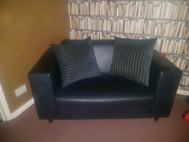 Small black leather sofa