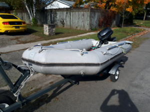 "Mercury 10'10""inflatable, 9.8 Mercury, trade for 15 to 25hp elec"