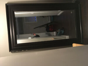 A huge mirror for sale ,in decent shape ,few chips in the boarde