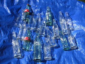 Assorted Coca Cola bottles