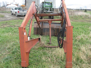 Hesston L365 Loader with 7' material bucket originally on 100-90
