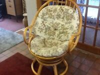 "Cane/wicker swivel chair With padded cushion 32"" wide Some marks - see photo Very comfy"