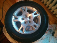 Set of 4 Dodge caravan wheels and tires.