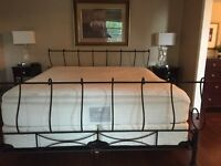 Solid iron bed frame with mattress