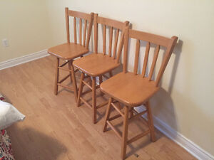 Three swivel wooden stools