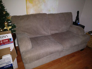 Two Ashley Sofas in great condition, moving sale.