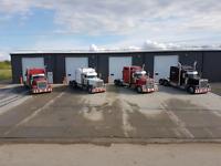 Heavy Equipment Transportation.  Farm implement towing & hauling
