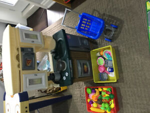 Play kitchen with cart, plates, food and shopping cart
