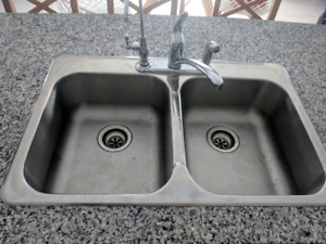 Stainless steel kitchen sink with moen faucet