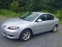 Mazda3 2005 automatique avec justement 135000 km !!!!!!!!!