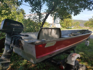 14ft Aluminum fishing boat with 6hp Evinrude