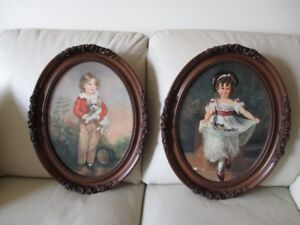 two matching oval pictures with frames