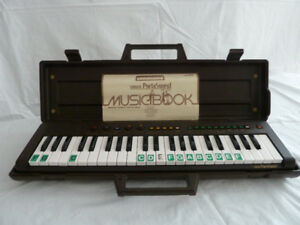 Yamaha Portasound with Case & Music Book - Like New!