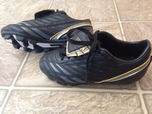For sale kids WILSON soccer cleats- size Youth 11. Brand New