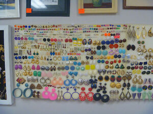Several Pairs Of Earrings Stating At 50 Cents Per Pair