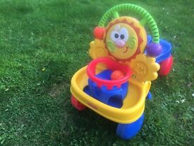 Toddler Fisher-Price push along or sit on toy with balls